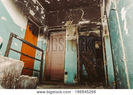 Entrance in an abandoned house, burnt apartment, stairwell, Fire and its consequences