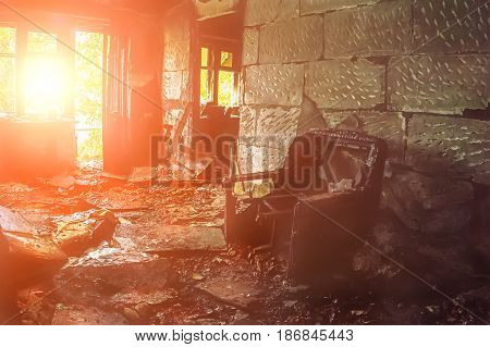 The burned-out house inside interior, room bathed in sunlight