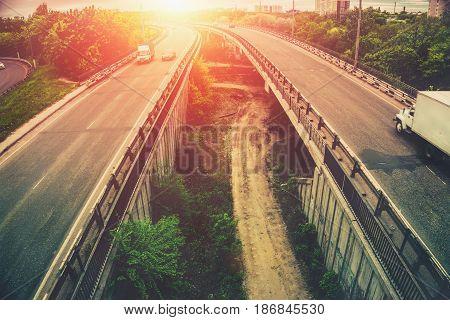 Highway tragic at sunset, big urban city bridges, transportation concept