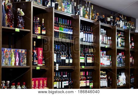 CYPRUS, PROTARAS - 13 OCTOBER 2016: Shelves with bottles of wine in the souvenir shop