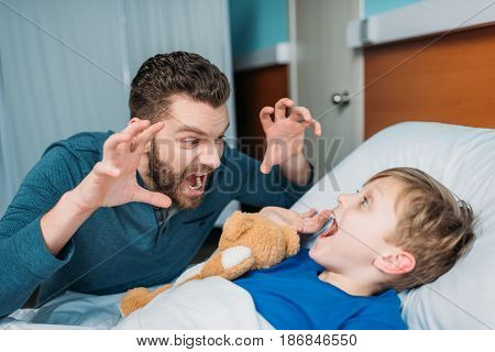 dad and son playing in hospital chamber