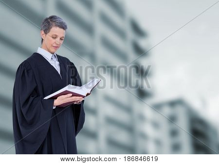 Digital composite of Judge holding book in front of buildings