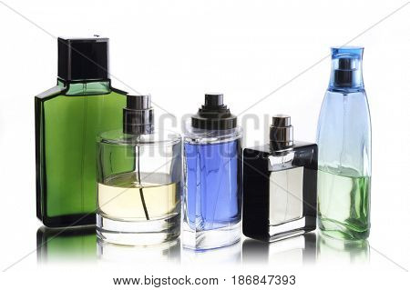 Group parfum bottles isolated on white background close up for trendy man