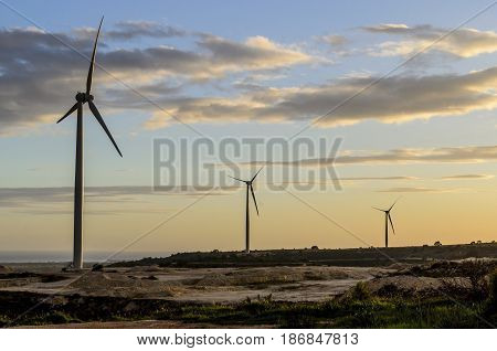 Wind turbines during a sunset in Cyprus