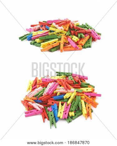 Pile of colorful wooden clothespins isolated over the white background, set of two different foreshortenings