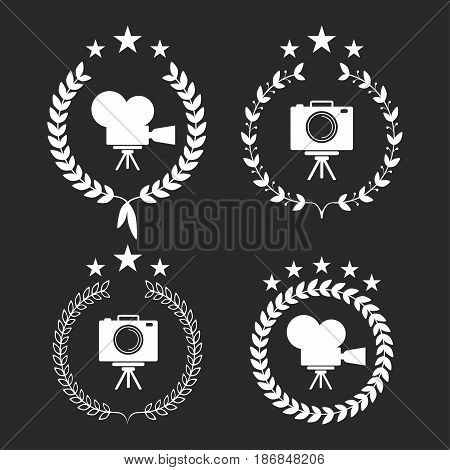 Film awards. Award laurel wreaths symbols with camera and stars. Vector