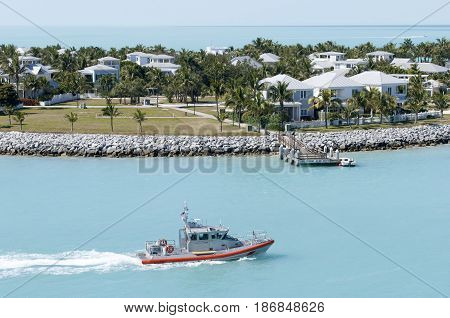 The boat passing by Sunset Key residential district island in Key West town (Florida).
