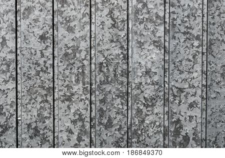 Closeup stainless steel corrugated sheet. Ridged reinforced metal surface for protection. Metallic background texture.