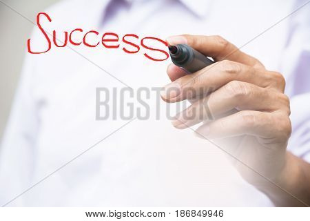 businessman writing success word with red white board pen on whiteboard