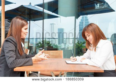 Businesswoman or manager interview her candidate - interview concept