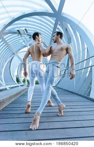 couple of two male dancers performance a acrobatic ballet pose