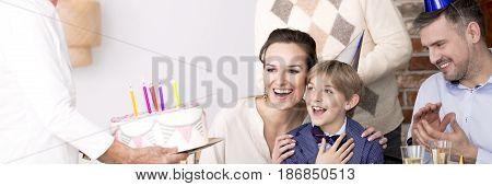 Boy Surprised With Birthday Cake
