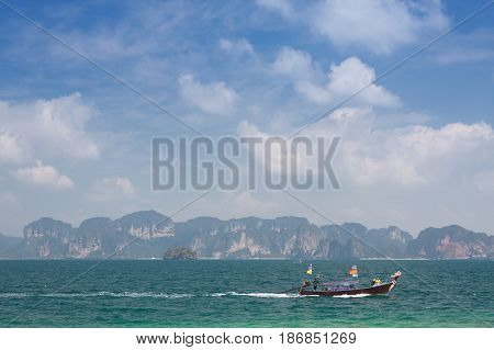 Traditional thai longtail boat in emerald sea at KrabiThailand