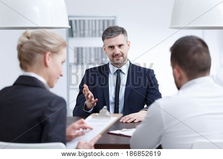 Man Convincing Examination Board