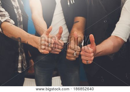 Young male team show thumb up sign. Like gesture from stylish men, hands closeup