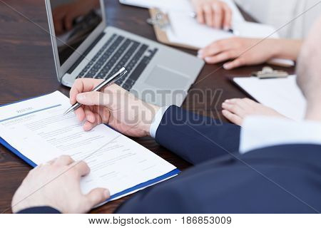 Members of cadre checking a resume after recruitment review