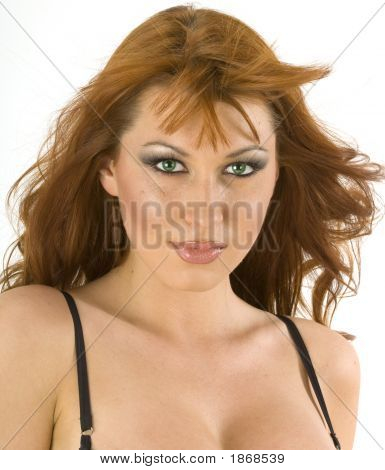 A Beautiful Redheaded Woman Against A White Background