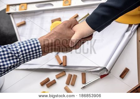 Two Engineer Shaking Hands. Top View Of Two Men Shaking Hands.