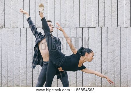 couple of two ballet dancers doing a choreography on the street