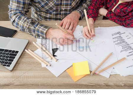 Businessman drawing with son at home office