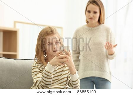 Quarrel between mother and daughter at home