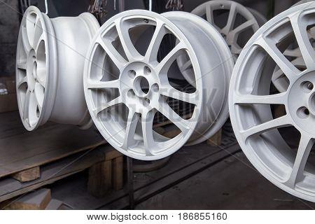 Powder coating of auto disks in workshop
