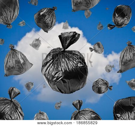 Black garbage bags in the blue sky. Environmental damage.