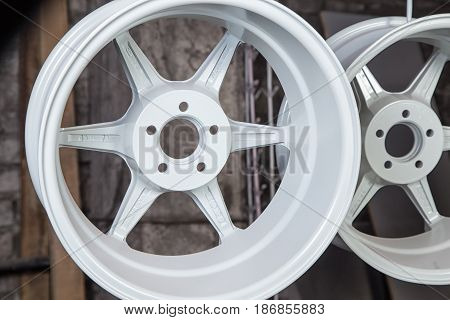 Powder coating and drying of wheels in workshop