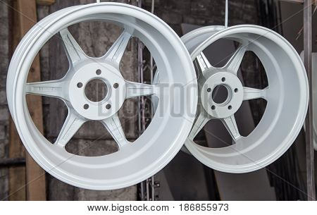 Powder coating and drying of auto disks in workshop