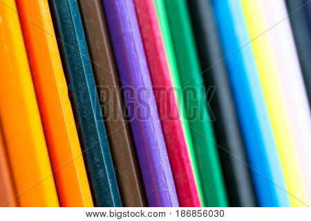 Abstract background made by variation of wooden hobby pencil color as bright colorful pattern structure and school education concept
