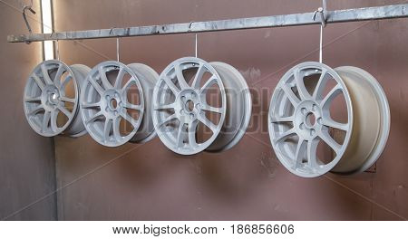 Drying of wheels after powder coating in workshop
