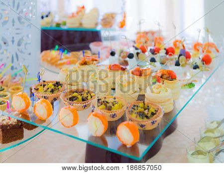 Delicacies and snacks in the buffet. Seafood. A gala reception. Banquet. Catering.