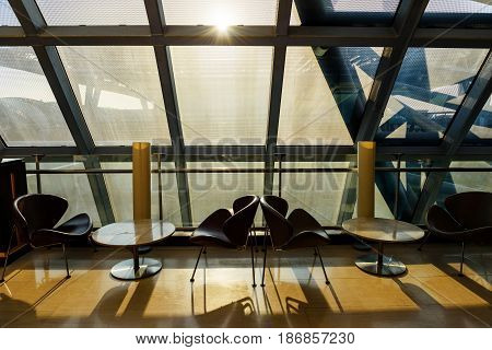 Luxury seats in departure lounge at the airport during sunset