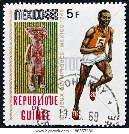 GUINEA - CIRCA 1969: a stamp printed in Guinea shows Sculpture and Runner 19th Olympic Games Mexico City circa 1969