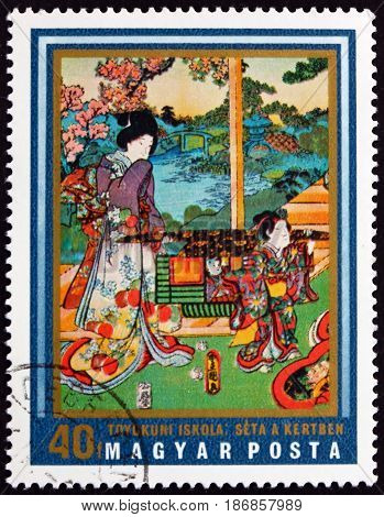 HUNGARY - CIRCA 1971: a stamp printed in Hungary shows Walking in Garden Tokyo School Japanese Art circa 1971