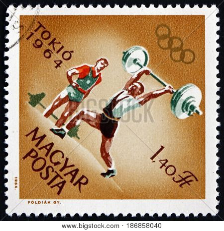 HUNGARY - CIRCA 1964: a stamp printed in Hungary shows Weight Lifting 18th Olympic Games Tokyo circa 1964