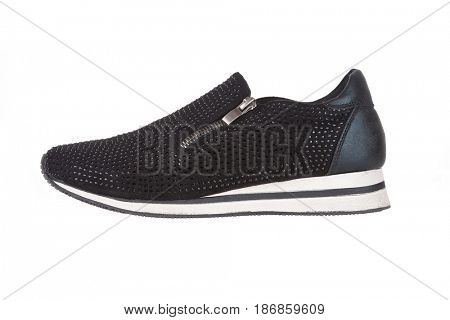 Black sneaker with rhinestones, isolated on white