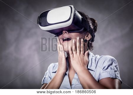 Worried business woman with virtual reality glasses.