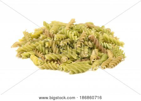 Bunch of green raw pasta fusilli on white background
