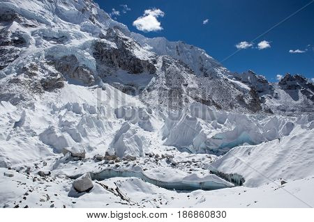 View Of Khumbu Glacier From Everest Base Camp, Himalayas, Nepal. Beautiful Turquoise Glacier Ice Lit