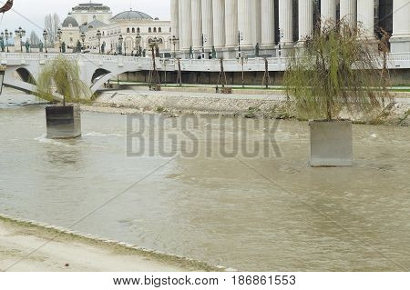 SKOPJE, MACEDONIA - MARCH 13, 2017: Promenade and sculpture near Vardar river in Skopje