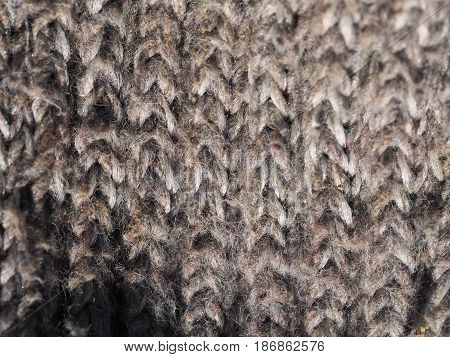 Rough Knitwear, woolen textile texture backdrop, macro. Grey color palette clothes fabric.