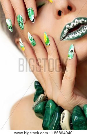 Stone blurred water manicure white,yellow,green and black nail Polish on oval acute form.Nail art.