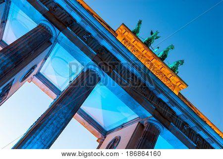 blue illuminatet brandenburger tor in berlin germany