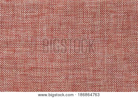 Light brown and white background of dense woven bagging fabric closeup. Structure of the ginger cloth with natural texture. Cloth backdrop.
