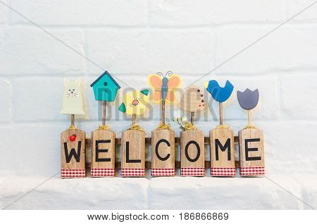 welcome text on the wall background and copy space
