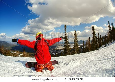 A guy snowboarder enjoys a holiday at the ski resort. Sheregesh Russia.