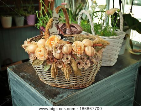 Beautiful Easter wicker basket with products in flower shop