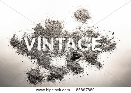 Word vintage written in grey dust ash dirt as a rustic outdated dirty industry symbol concept text