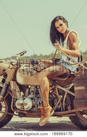 Sexy Biker Woman Is Sitting On The Bike And Holding The Rope In Hands.